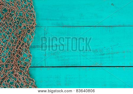 Blank teal blue aged wooden sign with fish net border
