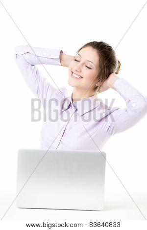 Smiling Young Girl With Dreamy Expression Taking A Break In Front Of Laptop