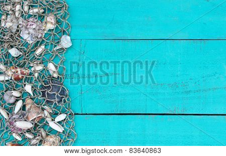 Fish netting with shells border on teal blue wood sign