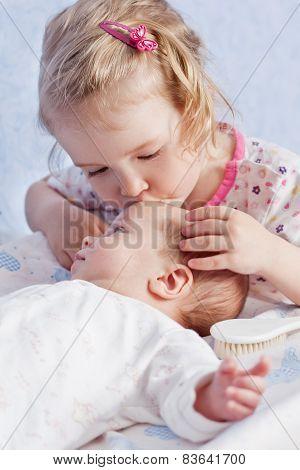 Cute Toddler Sister Kisses Newborn