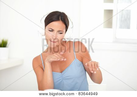 Stylish Woman Dancing While Listening To Music