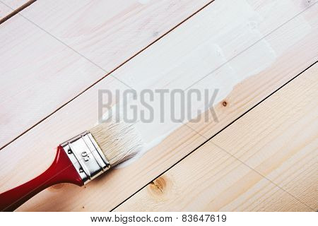 paint brush painting on wooden surface