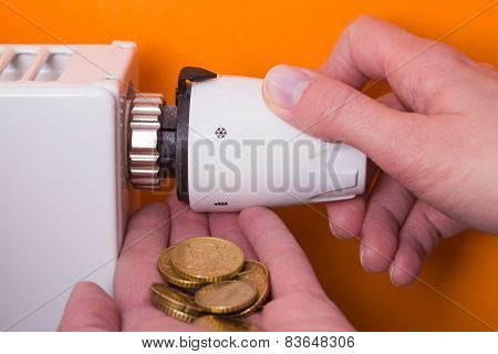 Radiator Thermostat, Coins  And Hand - Orange