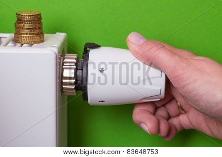 Radiator Thermostat, Coins And Hand - Green