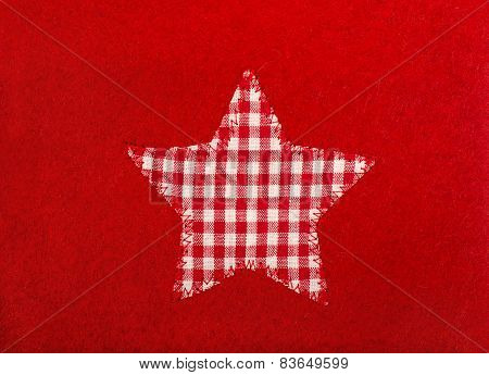 Star Shape On Red Wool Background.