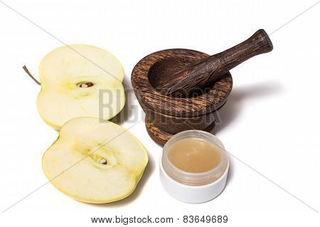 Wooden pounder with bottles of organic cream isolated