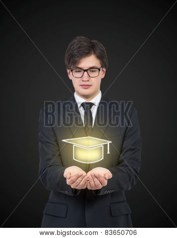 Businessman Holding Bachelor Hat