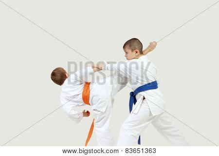 Little athletes perform paired exercises karate