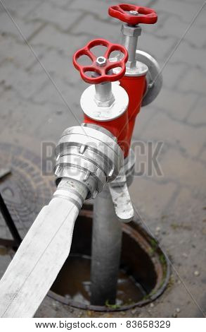 Hose Connected To Red Hydrant