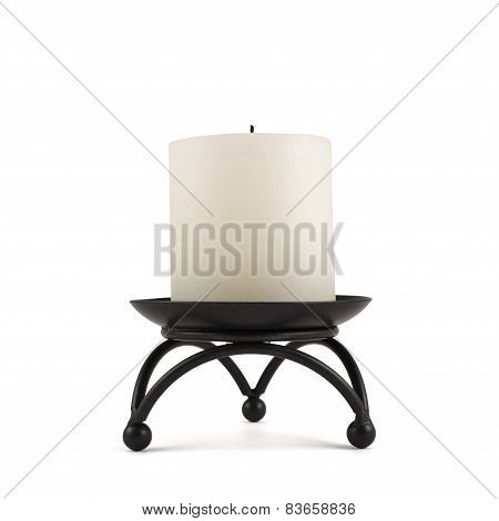 White candle over black metal stand
