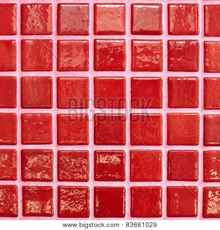 Wall tiled with red tiles