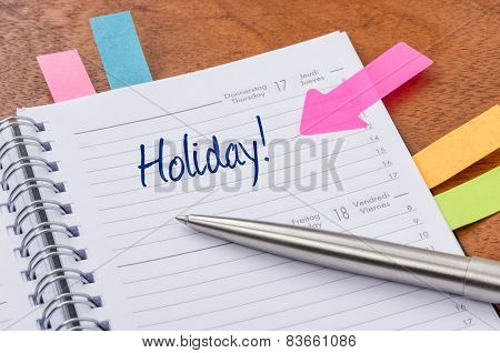 Daily planner with the entry Holiday