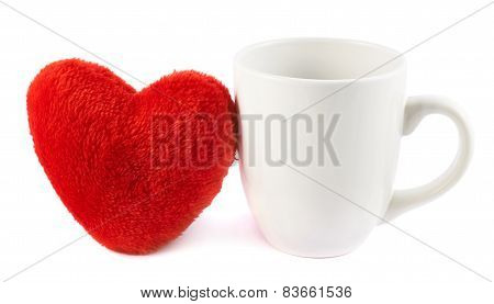 White cup next to a red heart