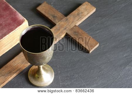 Chalice of wine bible and cross easter religion concept
