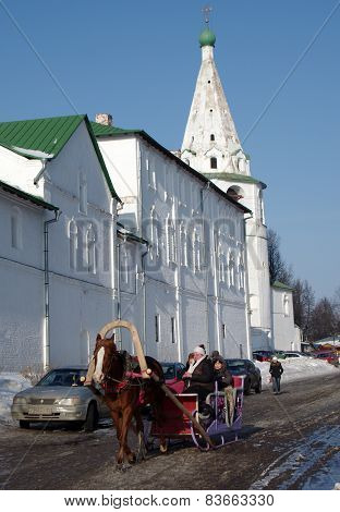 Horse Carriage On The Background Of The Kremlin In Suzdal