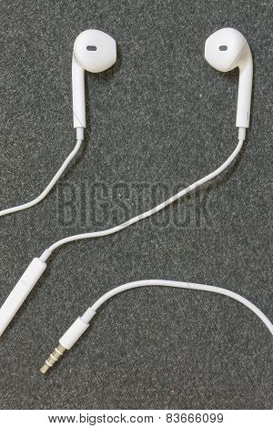 Earphones on a fabric background