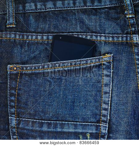 Smart phone in a back pocket of a jeans