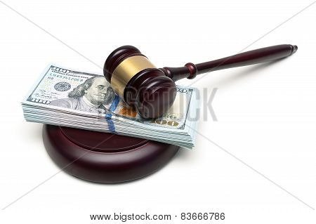 Gavel And A Big Wad Of Money Isolated On White Background