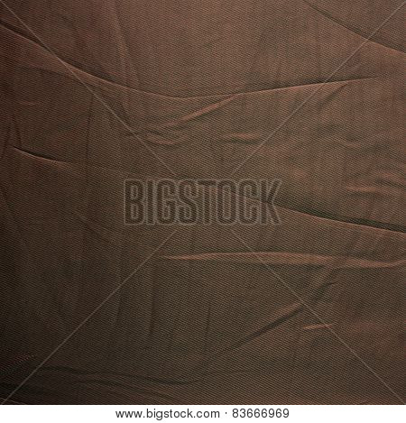 Striped creased brown silk material