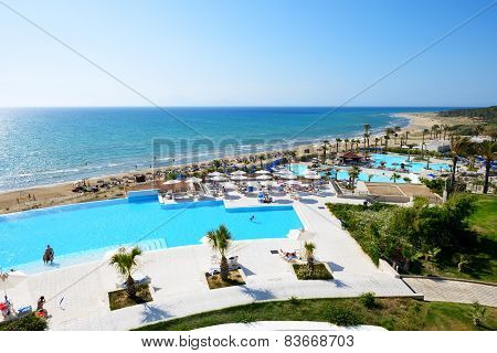 Patronikoleika, Greece - June 10: The Beach Of Luxury Hotel And Tourists Enjoing Their Vacation On J