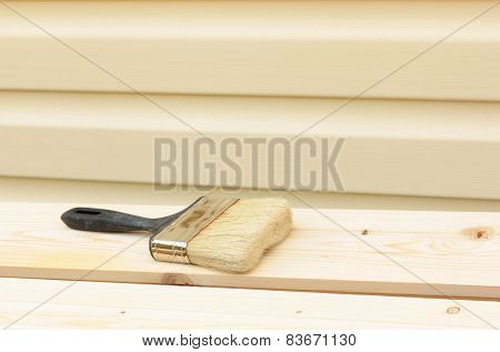 brush on wooden board