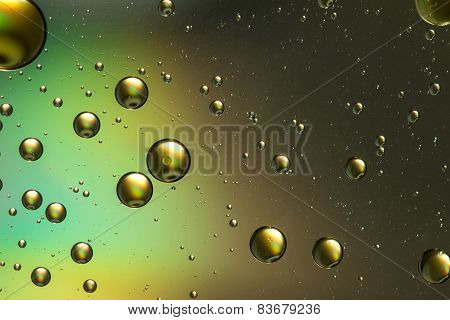 Blue, green, brown and gold oil and water abstract