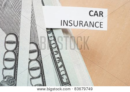 Paper with words car insurance and money.
