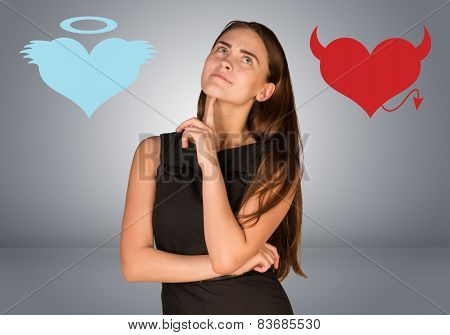 Woman musing between angel and devil hearts