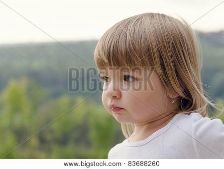 Potrait Of A Child Girl Outside