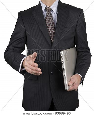 Man In Business Suit With Laptop