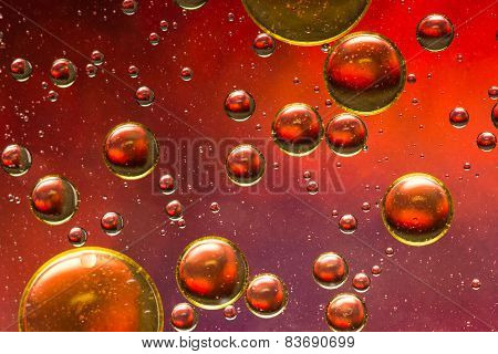 Red, purple and gold oil and water abstract