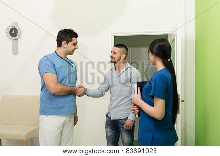 Dentist Congratulate Patient For A Successful Operation