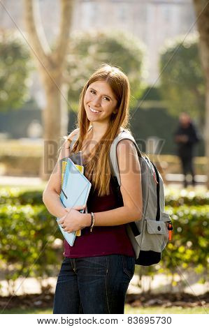 Young Attractive Student Girl In University Campus Green Park Carrying Books And Backpack