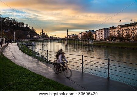 Two Bikes Next To Salzach River Of Salzburg