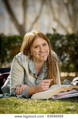Young Beautiful Student Girl On Campus Park Grass With Books Studying Happy Preparing Exam In Educat