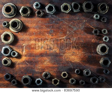 Screws On Dirty Wooden Table