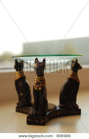 Three cat statues