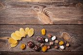 stock photo of ground nut  - nuts and dried fruits mix on wooden background - JPG