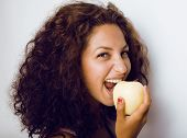 image of girl next door  - pretty young real tenage girl eating apple close up - JPG