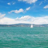 image of sailing vessels  - seascape with turquoise waters and sailing vessel - JPG