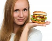 image of tomato sandwich  - Woman hold tasty unhealthy burger sandwich with cheese salad tomatoes slice and beef in hands hungry getting ready to eat isolated on a white background Fast food concept - JPG