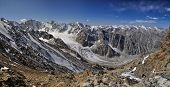 stock photo of shan  - Scenic panorama of glacier in Ala Archa national park in Tian Shan mountain range in Kyrgyzstan - JPG