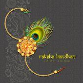 foto of rakhi  - Beautiful rakhi with gems on shiny green background for the festival of Raksha Bandhan celebrations - JPG