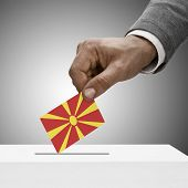 pic of macedonia  - Black male holding flag - JPG
