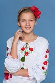 pic of preteen  - A cheerful preteen Ukrainian girl against the blue background - JPG
