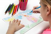 foto of drawing  - Child draws a pencil drawing of the world - JPG