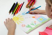 image of daycare  - Child draws a pencil drawing of the world - JPG