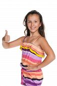 pic of preteen  - A pretty preteen girl holds her thumb up against the white background - JPG