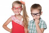 foto of clever  - Two clever children stand on the white background - JPG