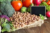 image of pinto bean  - Pinto beans and vegatables on the old wooden table - JPG